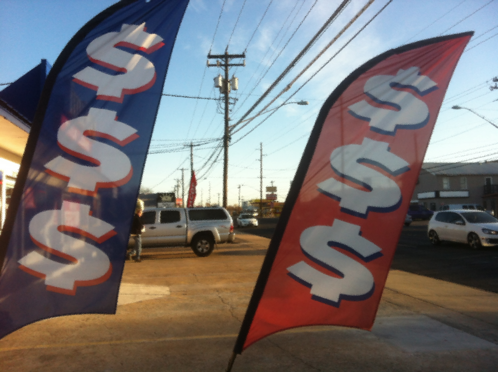 Banners at payday lending site. Photo by author.